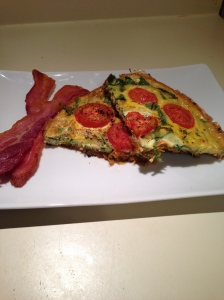plated frittata, garnished with bacon