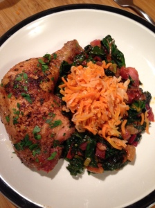 fermented carrots and ginger on top of swiss chard