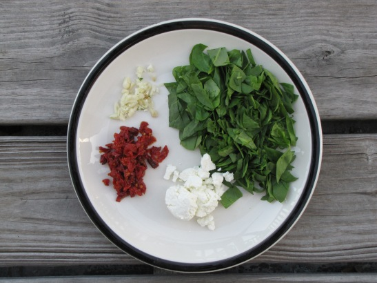 chopped baby spinach, garlic, sun-dried tomatoes, goat cheese